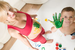 Woman and her son drawing Royalty Free Stock Photos