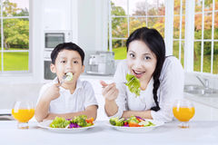 Woman and her son enjoy salad Stock Photo
