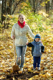 Woman with her son making orchard   in autumn Stock Photos