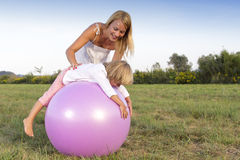 Woman and her son playing outdoors Royalty Free Stock Photo