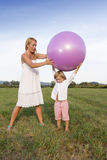 Woman and her son playing outdoors Stock Photos