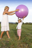 Woman and her son playing outdoors Stock Images