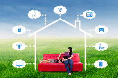 Woman and her son sit under smart house design Royalty Free Stock Photography