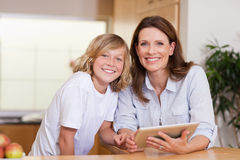 Woman and her son using tablet Royalty Free Stock Photo