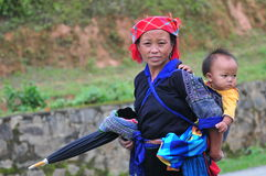 A woman with her son walking to the market in Hagiang, Vietnam Royalty Free Stock Image