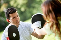 Woman and her sports trainer Royalty Free Stock Photography