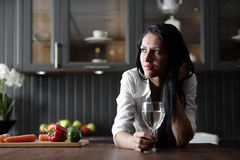 Woman in her stylish kitchen Stock Images