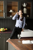 Woman in her stylish kitchen Stock Photography