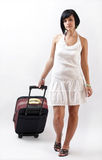 Woman with her suitcase Royalty Free Stock Photography