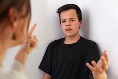 Woman and her teenager son having a quarrel - gesturing to emphasize the arguments stock images