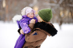 Woman with her toddler daughter at the winter park Stock Image