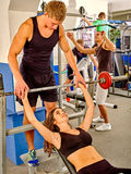 Woman with her trainer  working dumbbells at gym Royalty Free Stock Photos