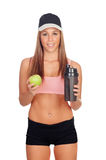 Woman after her training, drinking protein shake and with an app Royalty Free Stock Images