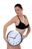Woman in her underwear. Holding a large clock Royalty Free Stock Image