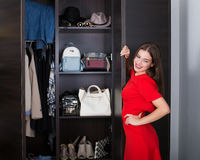 Woman and her wardrobe Royalty Free Stock Photography