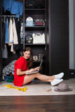 Woman and her wardrobe Stock Photos