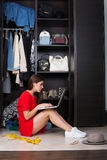 Woman and her wardrobe Stock Photo