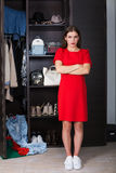 Woman and her wardrobe Stock Photography