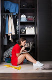 Woman and her wardrobe Royalty Free Stock Photos