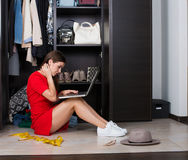 Woman and her wardrobe Stock Images