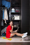 Woman and her wardrobe Stock Image