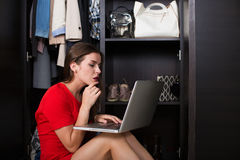 Woman and her wardrobe Royalty Free Stock Photo