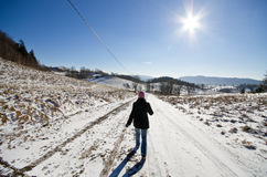 Woman on the way during the winter Stock Image