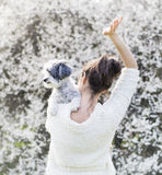 Woman  with  her white poodle  dog in a spring garden Royalty Free Stock Photo