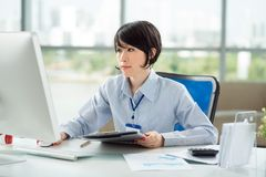 Woman at her workplace Stock Photos