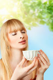 Woman with herbal tea Royalty Free Stock Photos