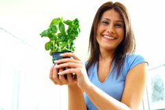 Woman with herbs. Young woman with green herbs Royalty Free Stock Images