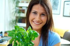 Woman with herbs. Young woman with green herbs Stock Photo