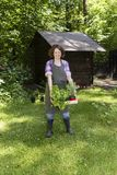 Woman with herbs in a garden Stock Photo