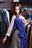 Woman hesitates about dress Stock Photography