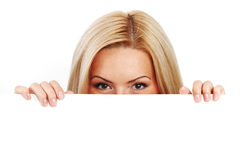 Woman hidden behind paper Stock Photography