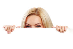 Woman hidden behind paper Royalty Free Stock Images