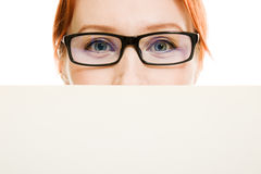 Woman hidden behind a white sheet of paper Royalty Free Stock Images