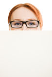 Woman hidden behind a white sheet of paper Royalty Free Stock Photography