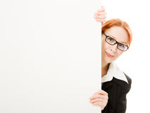 Woman hidden behind a white sheet of paper Stock Images