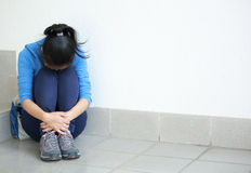 Woman hide in the corner Stock Image