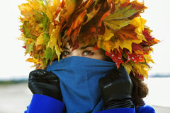 Woman hide face under scarf Stock Photography