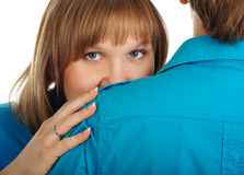 Woman hides behind her man shoulder Stock Photos