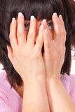 Woman hides her face Royalty Free Stock Photo