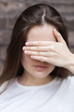 Woman hides her face palm Royalty Free Stock Photo