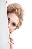 Woman hiding. Behind the door Stock Photo