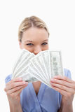 Woman hiding behind bank notes Stock Images