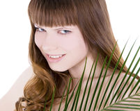Woman hiding behind the big green palm leaf Stock Photo