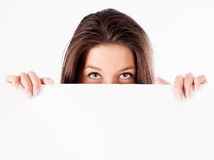 Woman hiding behind billboard Stock Photos