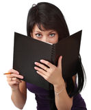 Woman hiding behind book Royalty Free Stock Image