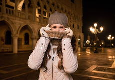 Woman hiding behind the collar while spending fun time in Venice Royalty Free Stock Image